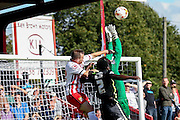 Stevenage Midfielder Charlie Lee competes for the ball with York City goalkeeper Scott Flinders & York City defender Marvin McCoy during the Sky Bet League 2 match between Stevenage and York City at the Lamex Stadium, Stevenage, England on 12 September 2015. Photo by Simon Davies.