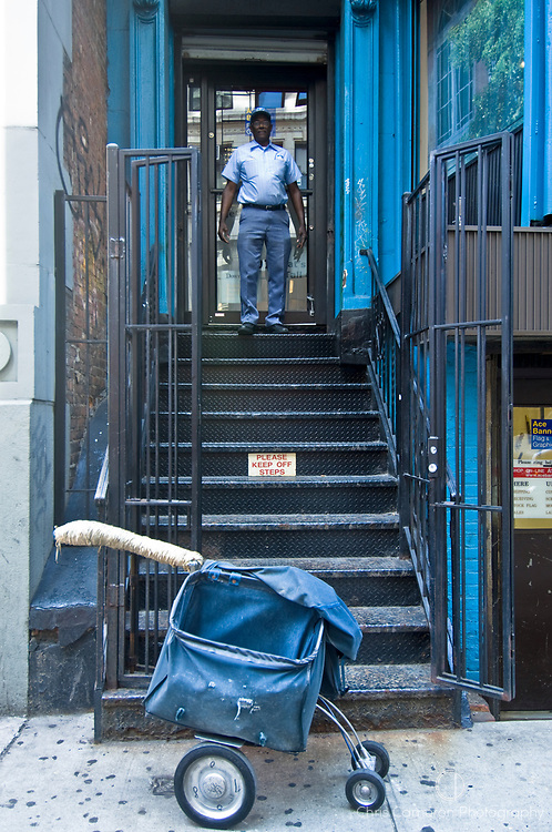 New York City Mailman exiting an apartment building in Manhattan.