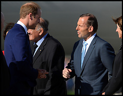The Duke of Cambridge talks to Prime Minister Tony Abbott as The Duke and Duchess of Cambridge arrive at Sydney airport, Australia, with Prince George on day 10 of their Royal Tour of New Zealand and Australia, Wednesday, 16th April 2014. Picture by Andrew Parsons / i-Images