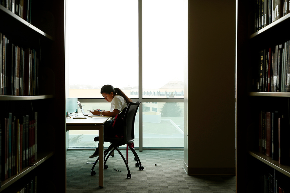 Victoria Romero, 20, studies in the library at San Francisco State University, Tuesday, May 8, 2018, in San Francisco, Calif. A group of four La Taqueria employees successfully complained to the city and state about unpaid overtime, sick time and healthcare benefits, forcing owner Miguel Jara to pay $500,000 in damages. Victoria was the youngest of the women, a criminal justice student who worked there for a year.