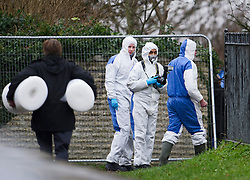 © London News Pictures. 18/12/2013 . Didcot, UK. A Police forensics team at the scene in a graveyard at All Saints Church in Dicot where police have started searching in connection with the disappearance of teenager Jayden Parkinson who has been missing since December 3rd. 22 year-old Ben Blakeley has been charged with the murder of 17-year-old Jayden. Photo credit : Ben Cawthra/LNP