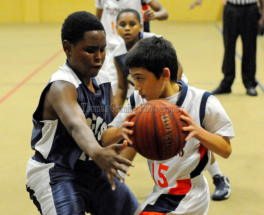 Charles Henderson Middle School's Orion Oates (15) looks for room past Barbour County Junior High's Latrell Chism (14) during a basketball game in Troy, Ala., Thursday, Dec. 20, 2012. (Photo/Thomas Graning)