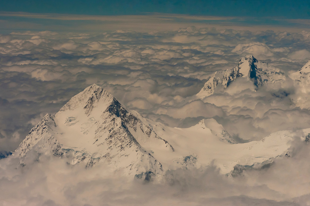 Aerial view above snowcapped peaks of the Himalayas between Kathmandu, Nepal and Lhasa, Tibet (China).