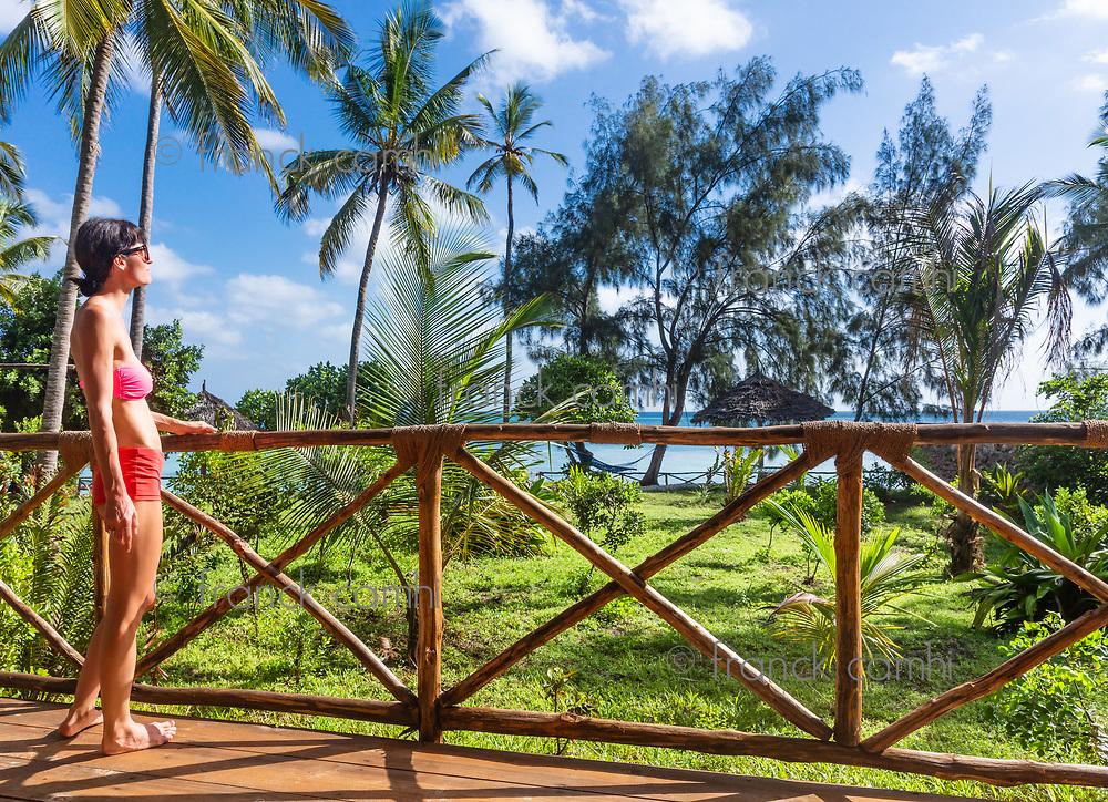 one caucasian woman enjoying vacations looking at a tropical landscape Kizimkazi in Unguja aka Zanzibar Island Tanzania East Africa