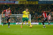 Norwich City forward Alex Pritchard (21) sprints forward Brentford's Kamohelo Mokotjo Brentford's Yoann Barbet defending during the EFL Sky Bet Championship match between Norwich City and Brentford at Carrow Road, Norwich, England on 22 December 2017. Photo by Phil Chaplin.