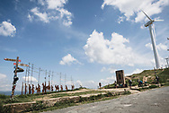 Pilgrims reach the summit at Alto del Perdón on the Camino de Santiago, located about 3.5 kilometers from Uterga, Spain. The summit is home to wind turbines as well as a wrought iron sculpture depicting pilgrims walking the Camino. (June 2, 2018)<br /> <br /> DAY 6: PAMPLONA TO UTERGA -- 17 KM