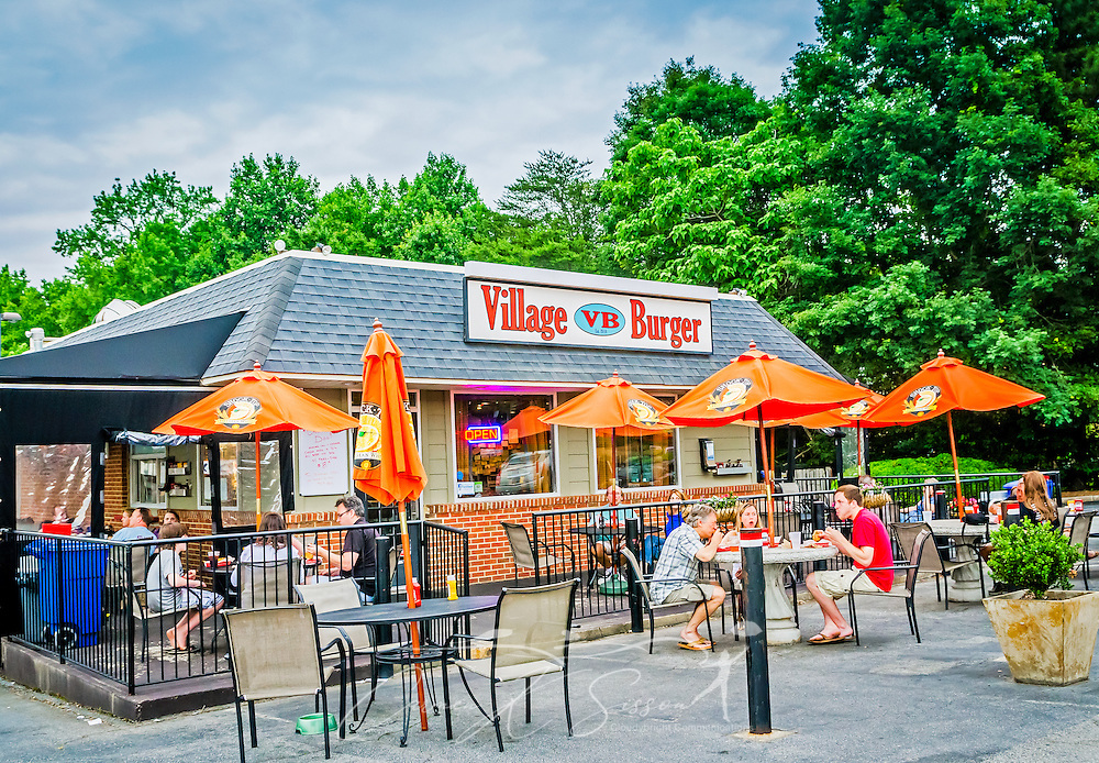 Patrons eat at Village Burger, June, 1, 2014, in Dunwoody, Georgia. The family-owned restaurant was established in 2010. (Photo by Carmen K. Sisson/Cloudybright)