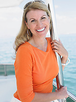 Middle-aged woman on yacht smiling portrait