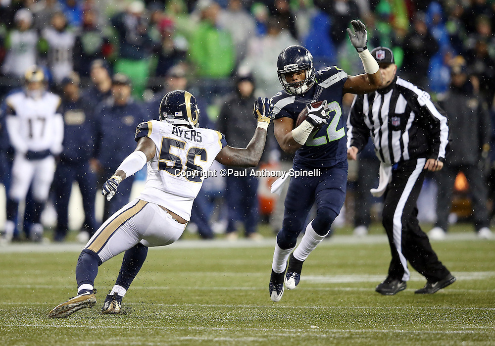Seattle Seahawks running back Fred Jackson (22) is chased by St. Louis Rams outside linebacker Akeem Ayers (56) as he catches a fourth quarter pass good for a gain of 9 yards to the St. Louis Rams 26 yard line with about one minute left during the 2015 NFL week 16 regular season football game against the St. Louis Rams on Sunday, Dec. 27, 2015 in Seattle. The Rams won the game 23-17. (©Paul Anthony Spinelli)