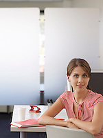 Businesswoman at desk half length