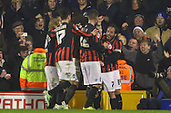 Adrian Colunga of Brighton and Hove Albion (2nd left) celebrates scoring the opening goal against Fulham during the Sky Bet Championship match at Craven Cottage, London<br /> Picture by David Horn/Focus Images Ltd +44 7545 970036<br /> 29/12/2014