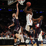 Dustin Hogue, Iowa, drives to the basket defended by Niels Giffey, UConn, during the Iowa State Cyclones Vs Connecticut Huskies basketball game during the 2014 NCAA Division 1 Men's Basketball Championship, East Regional at Madison Square Garden, New York, USA. 28th March 2014. Photo Tim Clayton