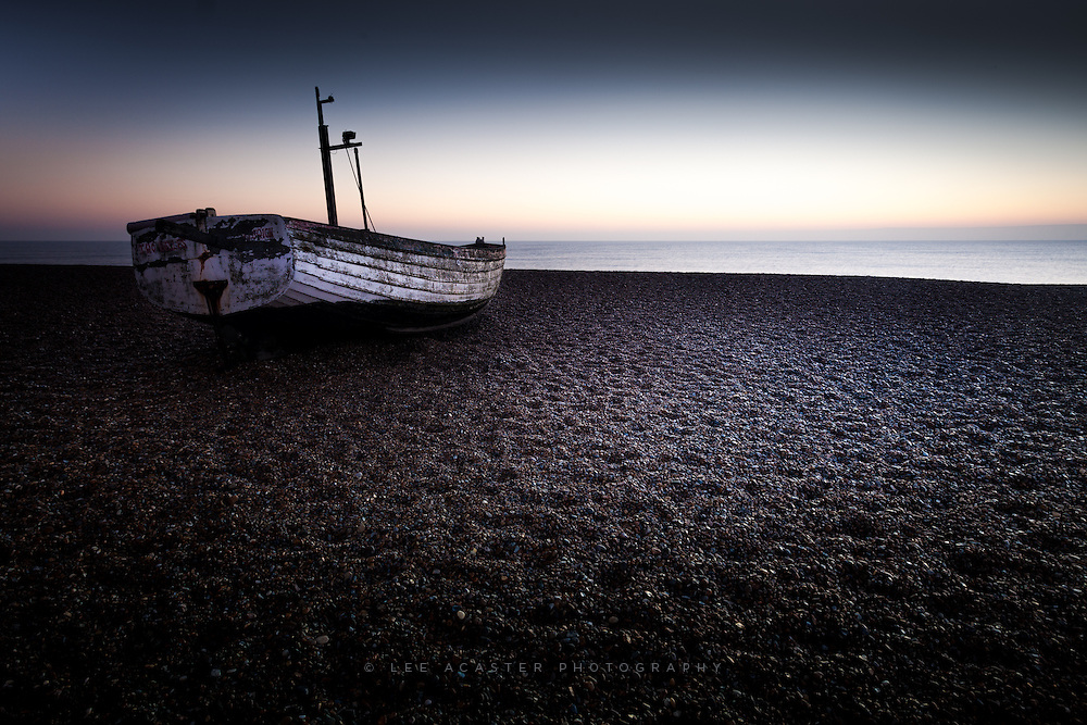 A lonely boat adrift on a sea of shingle at Aldeburgh