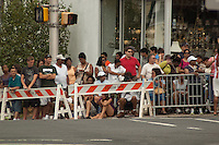 Spectators line the barricades along Rt. 27 in anticipation of a glimpse of the Presidential limousine.