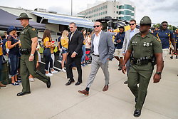 Sep 22, 2018; Morgantown, WV, USA; West Virginia Mountaineers head coach Dana Holgorsen walks through fans to the stadium for their game against the Kansas State Wildcats at Mountaineer Field at Milan Puskar Stadium. Mandatory Credit: Ben Queen-USA TODAY Sports