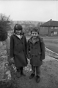 Two kids in duffle coats, High Wycombe, UK, 1980s.