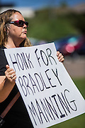 "06 JUNE 2012 - PHOENIX, AZ:   LIISA WALE pickets a street corner in Phoenix Wednesday in support of US Army PFC Bradley Manning. About 10 people gathered on a street corner in central Phoenix Wednesday to support Manning, who been criminally charged for passing secrets in the ""wikileaks"" case and is awaiting trial in a US Army jail.       PHOTO BY JACK KURTZ"
