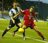 Photo: Aidan Ellis.<br /> Sheffield Wednesday v Cardiff City. Coca Cola Championship. 25/11/2006.<br /> Cardiff's Michael Chopra (R) holds off wednesday's Kenny Lunt