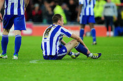 Sheffield Wednesday's Chris Lines sits on the floor after Cardiff score - Photo mandatory by-line: Dougie Allward/Josephmeredith.com  - Tel: Mobile:07966 386802 01/12/2012 - SPORT - FOOTBALL - Championship  -  Cardiff  -  New Cardiff Stadium  -  Cardiff City V Sheffield Wednesday