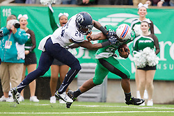 Oct 3, 2015; Huntington, WV, USA; Marshall Thundering Herd running back Tony Pittman is tackled by Old Dominion Monarchs safety Fellonte Misher during the second quarter at Joan C. Edwards Stadium. Mandatory Credit: Ben Queen-USA TODAY Sports