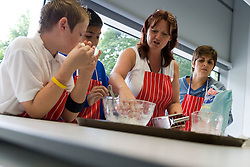 Food Studies teacher showing new students how to make sweets during their induction day,