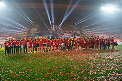 """LIVERPOOL, ENGLAND - Wednesday, July 22, 2020: Liverpool players and staff sing """"You'll Never Walk Alone"""" as they celebrate being crowned Premier League Champions during the FA Premier League match between Liverpool FC and Chelsea FC at Anfield. The game was played behind closed doors due to the UK government's social distancing laws during the Coronavirus COVID-19 Pandemic. (Pic by David Rawcliffe/Propaganda)"""