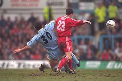 COVENTRY, ENGLAND - Saturday, April 6, 1996: Liverpool's Robbie Fowler in action against Coventry City's Liam Daish during the Premiership match at Highfield Road. Coventry won 1-0. (Pic by David Rawcliffe/Propaganda)