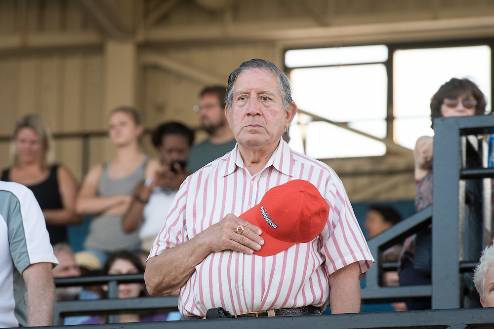 Timonium, Maryland - A man removes his hat while watching the parade from the stands at the 2016 Maryland State Fair.