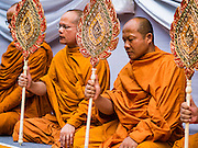 26 NOVEMBER 2016 - BANGKOK, THAILAND:  Buddhist monks lead a prayer for the late king of Thailand. Thousands of people gathered on Yaowarat Road in the heart of Bangkok's Chinatown to honor Bhumibol Adulyadej, the Late King of Thailand. The event was organized by the Thai-Chinese community and included a performance by the Royal Thai Navy orchestra of music composed by the Late King, a prayer by hundreds of Buddhist monks. It concluded with a candlelight vigil. The King died after a long hospitalization on October 13. The government has declared a one year mourning period. HRH Crown Prince Maha Vajiralongkorn, the Heir Apparent and Late King's son, is expected to be name the King next week. He will be known as Rama X.      PHOTO BY JACK KURTZ