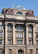 A new Ionic (or perhaps Ironic) architectural order at Narodowy Bank Polski , Basztowa, Kraków, Poland. Pigeon netting veiling the the sculptures and a rampant growth of mobile phone masts and  CCTV cameras subvert the meaning of the sombre 1925 architecture by Wyczy?ski and Hoffman