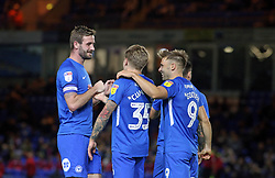Jason Cummings of Peterborough United is congratulated by team-mates after scoring - Mandatory by-line: Joe Dent/JMP - 09/10/2018 - FOOTBALL - ABAX Stadium - Peterborough, England - Peterborough United v Brighton and Hove Albion U21 - Checkatrade Trophy