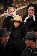 Amish children at the horse auction during the Annual Mud Sale to support the Fire Department  in Gordonville, PA.