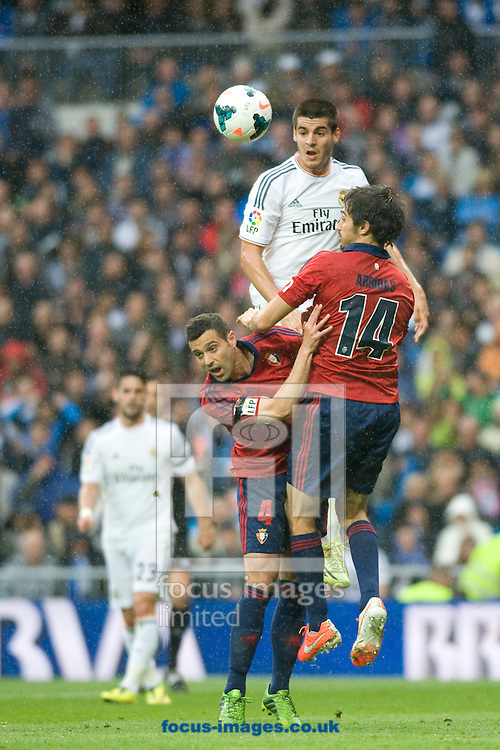 Alvaro Morata of Real Madrid jumps over the defense during the La Liga match at the Estadio Santiago Bernabeu, Madrid<br /> Picture by Marcos Calvo Mesa/Focus Images Ltd +34 654142934<br /> 26/04/2014
