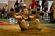 Wisconsin-Stout Hepthathlete Daniel Drewek lands hard in the sand during the long jump competition on Friday of the NCAA Division III Indoor Track and Field National Championships at Grinnell College.