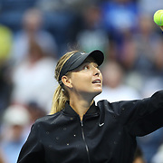 2017 U.S. Open Tennis Tournament - DAY THREE.  Maria Sharapova of Russia hits ball into the crowd after her win against Timea Babosof Hungary during the Women's Singles round two match at the US Open Tennis Tournament at the USTA Billie Jean King National Tennis Center on August 30, 2017 in Flushing, Queens, New York City.  (Photo by Tim Clayton/Corbis via Getty Images)
