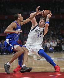 December 20, 2018 - Los Angeles, California, U.S - Avery Bradley #11 of the Los Angeles Clippers tries to block Luka Doncic #77 of the Dallas Mavericks during their NBA game on Thursday December 20, 2018 at the Staples Center in Los Angeles, California. Clippers defeat Mavericks, 125-121. (Credit Image: © Prensa Internacional via ZUMA Wire)