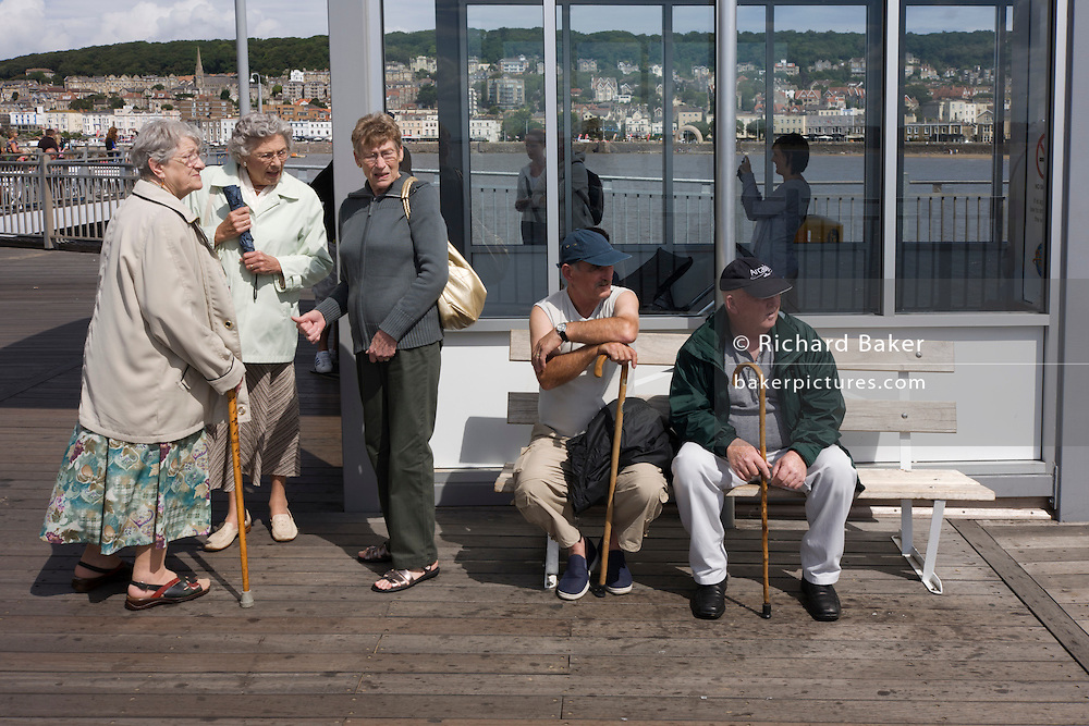 Visitors to the new Weston-super-Mare pier carry walking sticks.