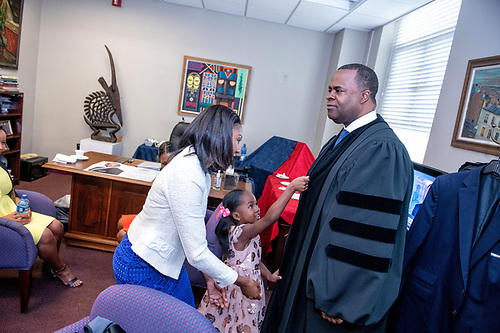 Kasim Reed, Mrs. Reed, and their daughter  in the President's office.