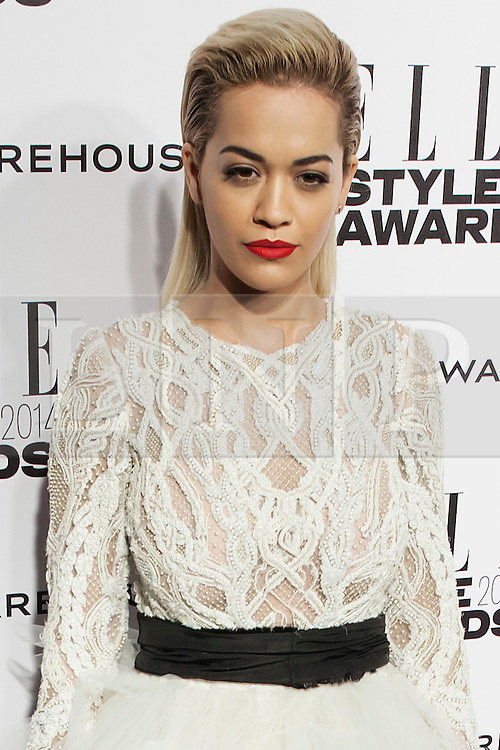 © Licensed to London News Pictures. 18/02/2014. London, UK. Singer Rita Ora arrives on the red carpet for the Elle Style Awards on the Embankment in central London. Photo credit : Andrea Baldo/LNP