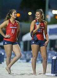 April 6, 2018 - Tucson, AZ, U.S. - TUCSON, AZ - APRIL 06: Arizona Wildcats defender Brooke Burling (31) celebrates with Arizona Wildcats defender Jonny Baham (11) during a college beach volleyball match between the Arizona State Sun Devils and the Arizona Wildcats on April 06, 2018, at Bear Down Beach in Tucson, AZ. Arizona defeated Arizona State 4-1. (Photo by Jacob Snow/Icon Sportswire (Credit Image: © Jacob Snow/Icon SMI via ZUMA Press)