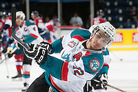KELOWNA, CANADA - MARCH 23: Tyrell Goulbourne #12 of the Kelowna Rockets takes a shot during warm up against the Tri-City Americans on March 23, 2014 at Prospera Place in Kelowna, British Columbia, Canada.   (Photo by Marissa Baecker/Shoot the Breeze)  *** Local Caption *** Tyrell Goulbourne;