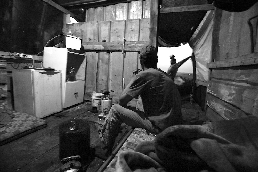 ..Hadder Kabah 17 and Gazmi Mohammad 22 in the hut next to the charcoals factory aria in the village of Arra.... ..Monday April 5, 2008,....