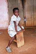 A girl in front of a closed shop in the town of Moloundu, South East Cameroon. *** Local Caption *** Photography &amp; copyright<br /> <br /> Elma Okic<br /> +44 7763 196 706<br /> turtle_danger@hotmail.com<br /> <br /> Queens Quay 504<br /> 58 Upper Thames Street<br /> London<br /> EC4V 3EH
