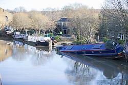 © Licensed to London News Pictures. 29/12/2015. Elland UK. Picture shows narrow boats left stranded on the banks of the Calder & Hebble Navigation at Greenway in Elland after recent flooding.  Photo credit: Andrew McCaren/LNP