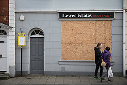 © Licensed to London News Pictures. 05/11/2016. Lewes, UK.  Shops in Lewes, East Sussex, are boarded up ahead of the annual bonfire night parade. The celebrations, which mark the Guy Fawkes 1605 Gunpowder Plot to blow up Parliament, date back to the 1850s. Photo credit: Rob Pinney/LNP