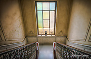 The elegant staircase of a once grand home in Vedado (built in 1926) features imperial marble and handrails made from cuban mahogany. The mansion also has many examples of ornate and simple styles of stained glass.