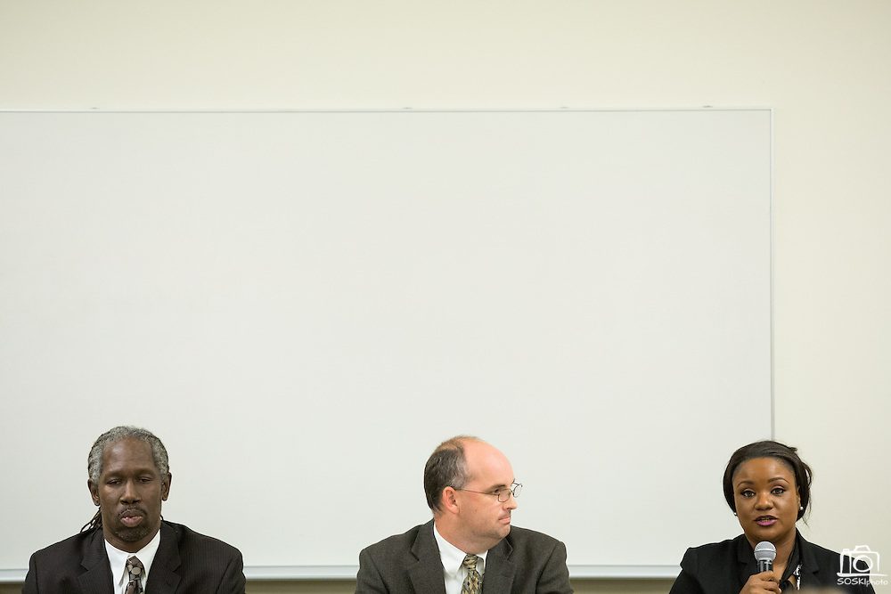 Demetress Morris (right) discusses the education progress gap between students, as David Freeman (center) listens, and Chris Norwood (left) prepares for his response during the Milpitas Unified School District Board of Education forum at the Barbara Lee Senior Center in Milpitas, California, on October 2, 2014. (Stan Olszewski/SOSKIphoto)