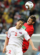 CAPE TOWN, SOUTH AFRICA, MONDAY 21 June 2010, Miguel Veloso challenges RI Myong Guk during the match between Portugal and Korea PRK held at the new Cape Town Stadium in Green Point during the 2010 FIFA World Cup..Photo by Roger Sedres/Image SA