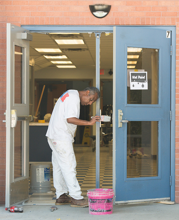 A worker puts finishing touches on renovations at Eastwood Academy.