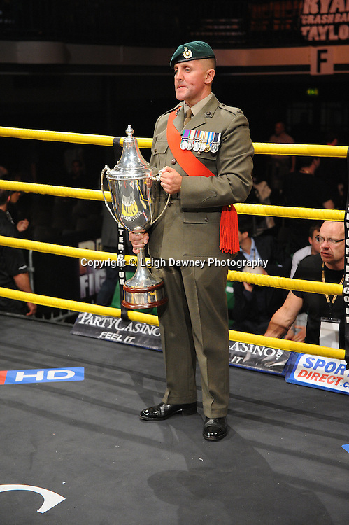 Member of the Armed Forces with prizefighter trophy at Prizefighter -  The Light Middleweights II. York Hall, Bethnal Green, London, UK. 15th September 2011. Photo credit: © Leigh Dawney.